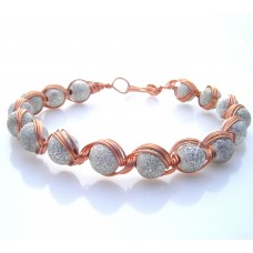 Silver coated sparkly glass beads wrapped in a copper wire.